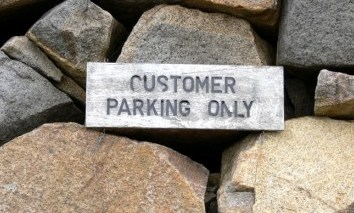 A Weathered Customer Parking Only Sign
